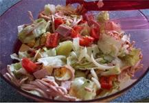 Мясной салат с вареной колбасой и ветчиной
